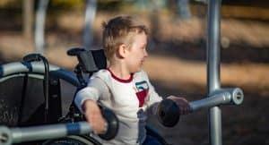 boy on inclusive swing